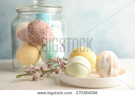 Plate With Colorful Bath Bombs On Table