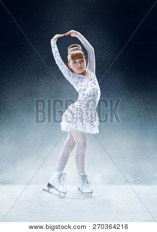Little Girl Figure Skating At The Indoor Ice Arena. The Dance, Sport, Winter, Exercise, Training, Ch