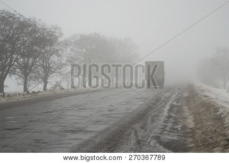 Novopskov, Ukraine - February 03th, 2018: Van Rides The Road Into The Fog. The Concept Of Poor Visib