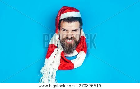 Christmas Sales. Angry Man In Santa Hat Looks Through Hole In Paper. Christmas, New Year, Holidays,