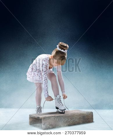 Little Girl Figure Laces Up His Shoes At The Indoor Ice Arena. The Dance, Sport, Winter, Exercise, T