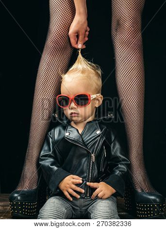 Forever Rocker. Rock And Roll Fashion Trend. Small Boy At Female Legs. Rock Style Child. Cute Little