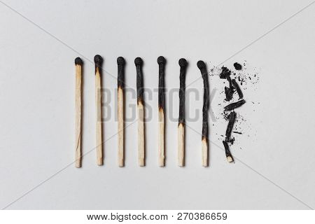 Concept Of Patience. A Row Of Burnt Matches, From Left To Right, From Almost A Whole Match To A Comp