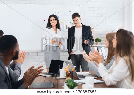 Female Boss Introducing New Hire Employee To Office Workers Clapping Hands Welcoming Coworker
