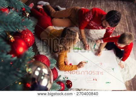 Happy Family: Father, Mother And Son Writing Future Resolutions And Plans Of Family In Coming 2019 N