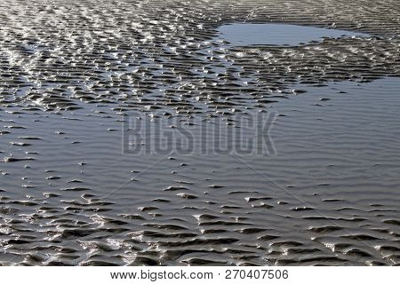 A Scenic, Shallow, Tide Pool By The Sea With Ripples Textured By The Light  Tide Pool; Tidepool, Wat