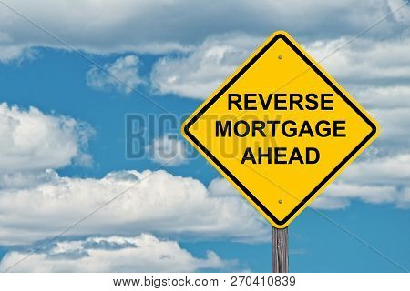 Reverse Mortgage Ahead Caution Sign With Blue Background
