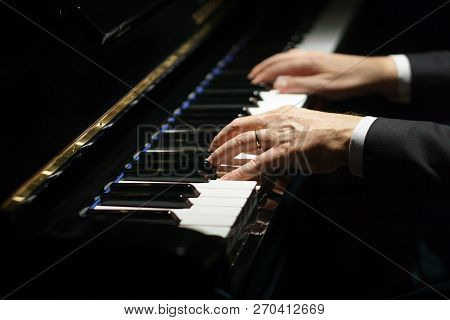 Professional Musician Pianist Hands On Piano Keys Of A Classic Piano.