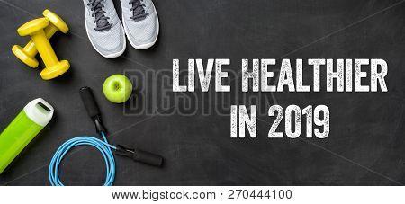 Live Healthier In 2019 Written On A Blackboard