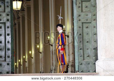 Vatican City, Vatican - March 20, 2010: Swiss Guard Standing Ground In Saint Peters Basilica
