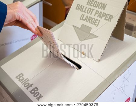 Melbourne, Australia - November 19, 2017: Woman Casting Her Vote In The 2018 Victorian State Electio