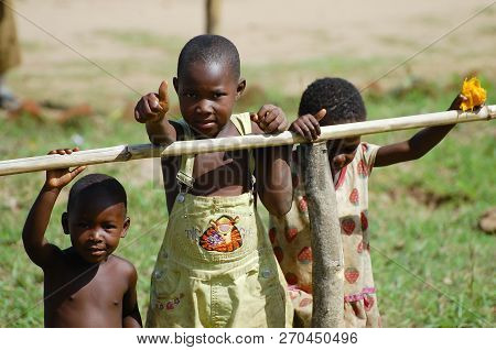 Mzuzu, Malawi - December 9, 2008: Children Waving To Tourists During A Safari Passing Through A Vill