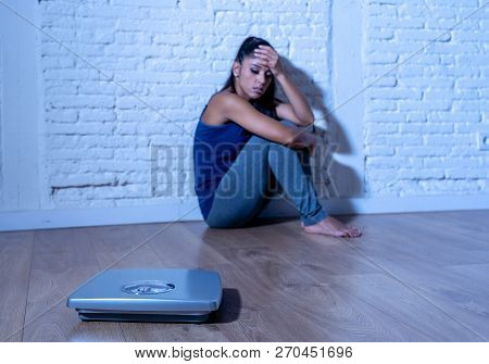 Sad Woman Or Teenager Girl Afraid Of Weight Looking At Scale In Nutrition Disorder