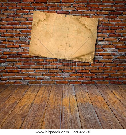 Grunge vintage old paper on brick wall and wood floor