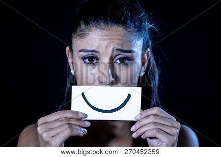Young Woman Suffering From Depression Hiding Her Sadness And Sorrow Behind A Drawn Smile
