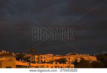 Dark Sky Before Thunderstorm In The Light Of Sunset