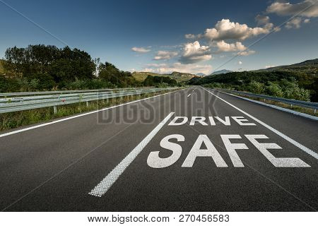 Drive Safe Message On Asphalt Highway Road Through The Countryside To The Mountains