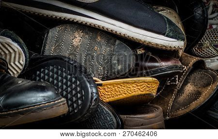 Close Up Of Old Dirty Male Shoes. Used Shoes. Heap Of Old Shoes. Many Of Dirty Men Shoe. Men Shoes C