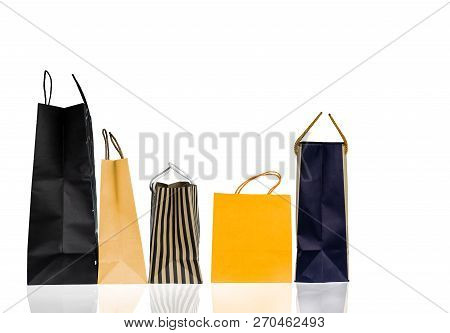 Five Paper Shopping Bags Isolated On White Background. Shopping Bag With Blue, Brown, And Yellow Col