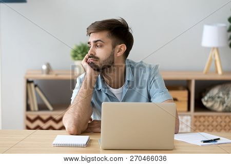 Tired Man Distracted From Computer Work Lacking Motivation