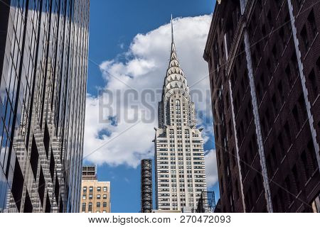 New York-july 22: The Iconic Chrysler Building Frames By Surrounding Buildings On A July 22 2015 In