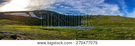 Beautiful Panoramic View Of The Lake In The Mountains And Blue Sky With Clouds. Lake In The Mountain