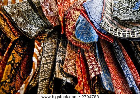 Indonesian traditional batik at the batik factory in Bandung Indonesia....comes in wonderful brilliant colors...the art of batik is inherited from generations to generations.... poster