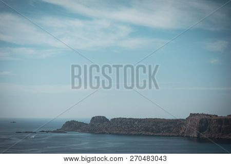 Reef Rock Near The Lindos Town On Rhodes Island