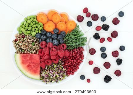 Super food for fitness concept  with health foods high in antioxidants, protein, anthocyanins, dietary fibre and vitamins. Top view on white wood.