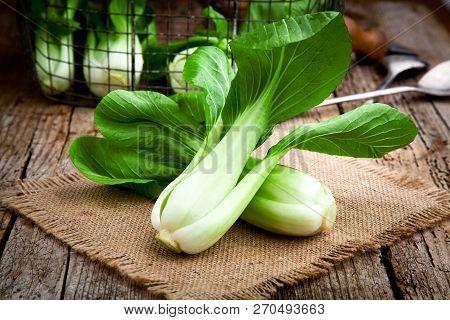 Vegetable Assortment, Fresh Green Chinese Cabbage, Bok Choy, Pok Choi Or Pak Choi On Dark Background