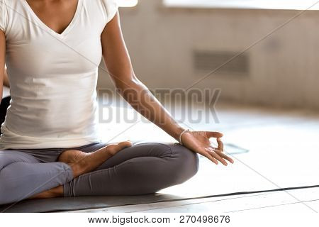 Young Sporty Black Woman Practicing Yoga, Doing Easy Seat Exerci