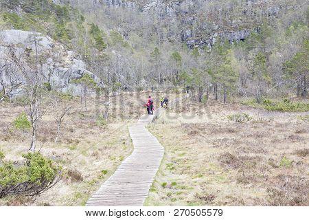 Preikestolhytta , Norway - May 13, 2017: Tourists On Trail To Preikestolen On May 13, 2017 In Preike