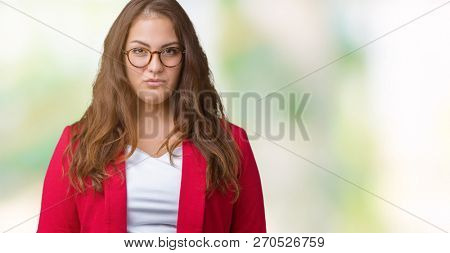 Beautiful plus size young business woman wearing elegant jacket and glasses over isolated background depressed and worry for distress, crying angry and afraid. Sad expression.