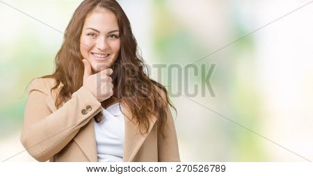 Beautiful plus size young woman wearing winter coat over isolated background looking confident at the camera with smile with crossed arms and hand raised on chin. Thinking positive.