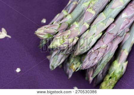 A Bunch Of Purple Asparagus With Copy Space.