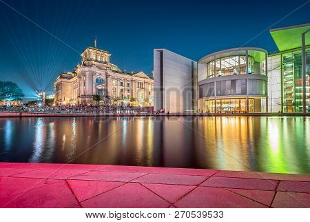 Panoramic Twilight View Of Famous Berlin Government District With Spree River During Blue Hour At Du