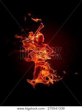 Fiery flamenco dancer. Fire flames on black background.
