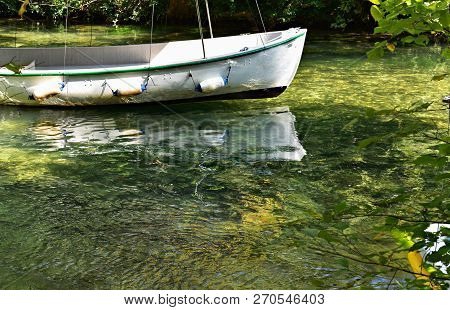 Peaceful Scenery With Colorful Wood Fishing Boat In The River/ Small White Boat On Green River
