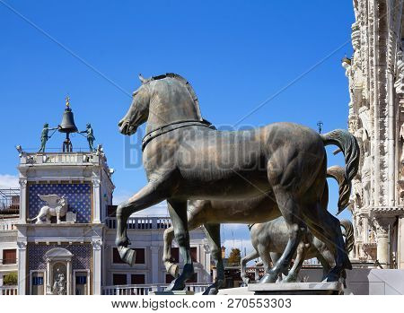 Horses Of Saint Mark (triumphal Quadriga) With Clock Tower In Background. Venice, Italy.