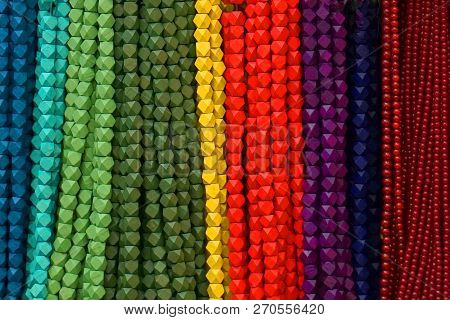 Colorful Beads Background. Background Pattern Of Multicolored Natural Stone Beads. String Of Beads I