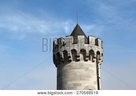 The Tower Of The Ancient Castle With Battlements