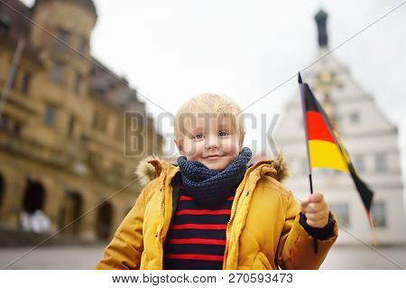 Little Boy With A German Flag On The Square In Rothenburg Ob Der Tauber. Small Town Of Deutschland.
