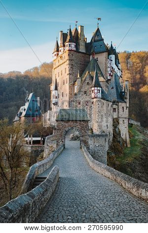 Beautiful View Of Famous Eltz Castle In Scenic Golden Morning Light At Sunrise With Blue Sky On A Su