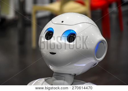 Leipzig, Germany - July 2, 2016: Head With The Lightning Eyes Of A Humanoid Robot Pepper Presented D