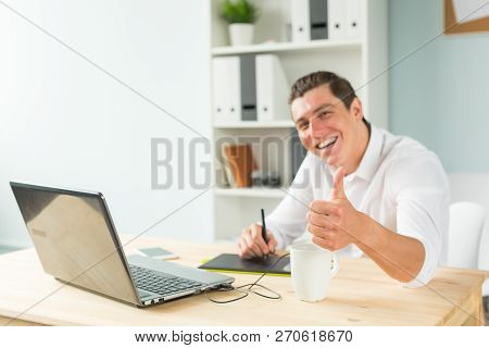Business, Humor And People Concept - Young Graphic Designer Man In White Shirt Gesture Thumb Up