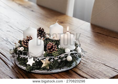 Lighting The First Candle On The Advent Wreath On The First Sunday In December To Celebrate The Begi