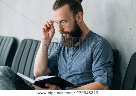 Man Thinking Over His Notes. Contemplation Planning And Brainwork.