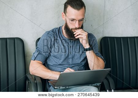 Man Reading Information From Laptop. Thinking Contemplating And Brainwork.