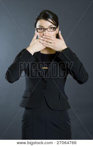 businesswoman in the Speak No Evil pose
