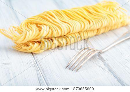 Fresh Homemade Egg Noodles. Italian Traditional Pasta.
